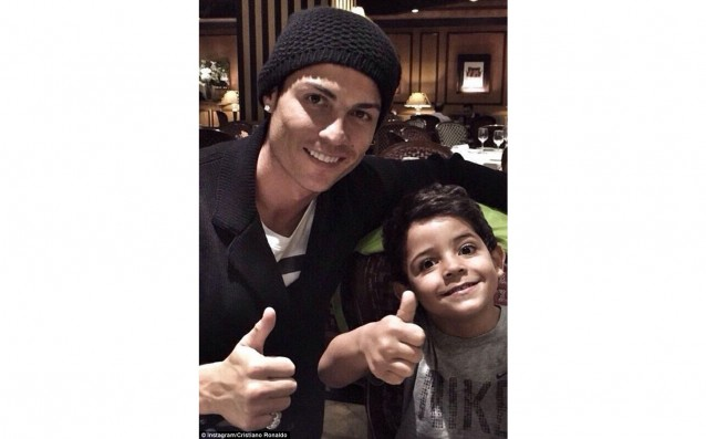 Ronaldo  celebrates the record with his son
