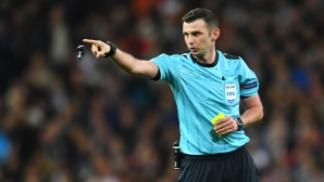 UEFA condemned threats against Michael Oliver and his wife